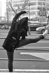 whitney (.kmo.) Tags: urban dance ballet stretch pose backpack jansport black white bw street shanghai china 365 girl pretty back car building railing