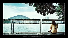 enjoying the sea breeze (mr ivanchan) Tags: woman lady leisure outdoor harbour sunlight daylight sky sea blue hongkong victoriaharbour carlzeiss zm zeisszm2821 21mm a7rii sony tree mountain building skyscraper city street back