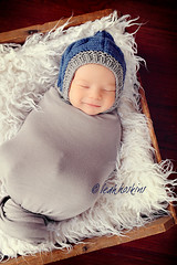 .sweet love. (*miss*leah*) Tags: blue winter boy smile hat fur nikon warm crochet gray wrapped newborn babyboy baboy swaddled nikond700 newbornprop leahhoskins professionalnewbornphotography