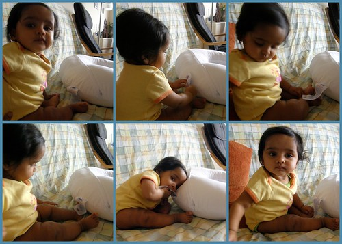 Sitting playing with label boppy pillow