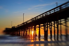 blurred sunset (lensbaby) (Eric 5D Mark III) Tags: ocean california sunset sky usa cloud blur color reflection beach silhouette lensbaby canon pier unitedstates perspective wave newportbeach orangecounty tone composer eos5dmarkii