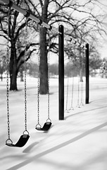 Empty Swings (pixelmama) Tags: winter blackandwhite snow shadows gettyimages 552 auroraillinois hbw emptyswings project52 churchroadpark focus52 bokehwednesday thebigfivetwo chicagoblizzard2011