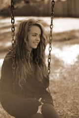 Kaitlyn (katierose) Tags: girl sepia hair nose happy 50mm bokeh happiness swing ring teen curly nikkor f18 teenage