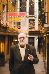 The Convict (Jeremy Snell) Tags: venice portrait italy man fashion lights italian alley cigar suit scholar venezia godfather classy