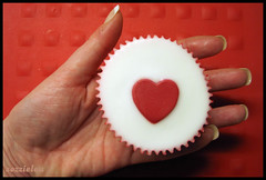 I give you my heart  (sozzielou) Tags: red white cake hand heart squares fingers valentine palm mat cupcake icing thumb vanilla loved ones share valentinesday shared explored