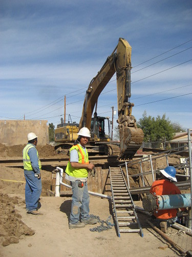 Construction crew members work on a trench at Avenue B&C Colonia