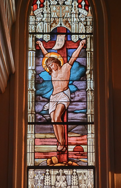 Saint Joseph Roman Catholic Church, in Louisiana, Missouri, USA - stained glass window detail of the Crucifixion