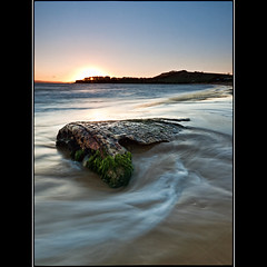 (David Panevin) Tags: longexposure morning sky bw sun seascape motion beach water sunrise landscape waves object australia olympus explore tasmania e3 cremorne sigma1020mmf456exdchsm explored southarm bwnd davidpanevin