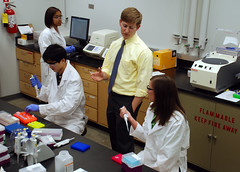 Chris Easley in his lab with grad students