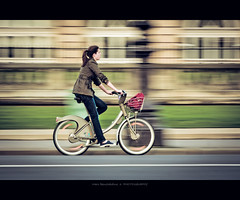 Parisienne (Marc Benslahdine) Tags: street paris bike candid route pan panning vlo bitume trottoir lightroom fil canonef70200f4lusm canoneos50d marcopix tripax marcbenslahdine originalpanning originalpan truepanning nophoshopeffect truepan wwwmarcopixcom wwwfacebookcommarcopix marcopixcom