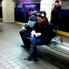 Taking Notes (pilechko) Tags: red woman station scarf bench subway jerseycity metro platform nj tiles grovestreet