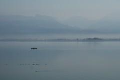 blue haze (kosova cajun) Tags: blue mountains landscape boat albania skadarskojezero shkodra shqipri peisazh lakeskadar shqipria shkodr lakescutari  liqeniishkodrs shirok bark
