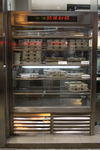 Display fridge full of steamed milk puddings