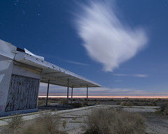 Edwards Whisp (Lost America) Tags: abandoned night clouds desert gasstation fullmoon timeexposure mojave petrol canopy nocturnes northedwards