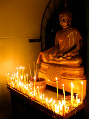 Buddha Image with 100s Candle Lights (Cheeky_Paper) Tags: flowers night temple candle buddha burn wat incense