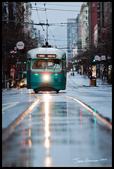 No. 1076 in the rain (jasontakesphotos) Tags: sanfrancisco california morning public electric america washingtondc nikon market north rail historic muni f transportation transit embarcadero tribute nikkor streetcar northern 70200 f28 fline pcc livery 1076 200mm fmarket wharves vrii dctransit afs70200mmf28gedvrii
