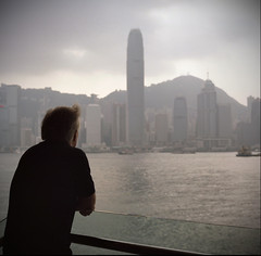 High Hopes (NyYankee) Tags: china old sea man 120 6x6 film skyline analog mediumformat hongkong central kowloon ifc kodakportra160vc pentaconsixtl ruckenfigur backsight carlzeissjenabiometar80mmf28
