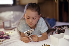 Girl playing with gun (Jim Corwin's PhotoStream) Tags: old playing girl closet for parents bedroom gun with young 8 jewelry while years handgun snooping discovers