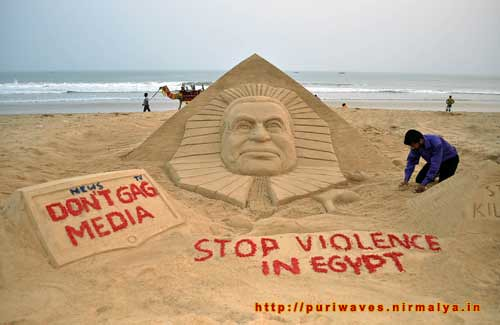 Stop Violence In Egypt - Sand Scuplutre by Sudarshan Pattnaik