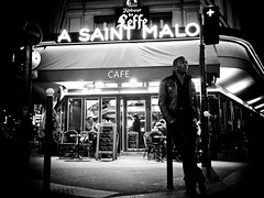 Almost Home, Montparnasse - Paris (adde adesokan) Tags: street travel light blackandwhite white man black paris france club night pen photography cafe frankreich watching streetphotography olympus trentreznor mann 20mm montparnasse weiss schwarz barriere lichter nach ep1 streetphotographer almosthome m43 mft mirrorless atticusross microfourthirds theblackstar mirrorlesscamera streettogs streetphotographycandidstreetportrait
