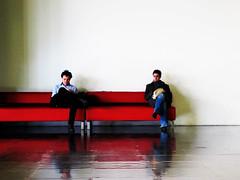 Red Sofa (preynolds) Tags: people reflection men waiting bfi redsofa britishfilminstitute