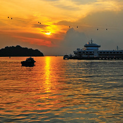 Have you been to Sentosa lately? (williamcho) Tags: sun boats singapore ngc silhouettes sunsets boardwalk sentosa attraction cablecars d300 warmtones williamcho harbourfrontterminal