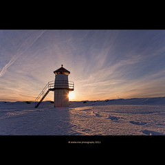 12 mars (stella-mia) Tags: winter sunset mars sun lighthouse snow norway backlight lensflare hamar sn hedmark 2470mm hightlight platinumheartaward canon5dmkii lakemjsa annakrmcke