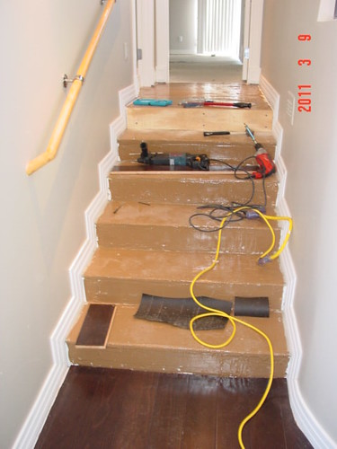 Prefinished Solid over concrete stairs