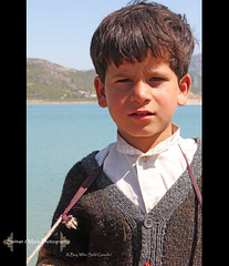 A Boy Who Sold Goods.! (Salman_Malik) Tags: boy canon dam roadtrip khanpurdam khanpur eos550d salmanjmalikphotography