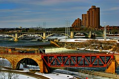 Mississipi & St. Anthony Falls (biosynthesis24) Tags: city vacation urban usa snow brick glass minnesota st architecture modern sunrise paul hotel march town midwest downtown cathedral cloudy radisson parking minneapolis overcast sunny center science clear conference metropolis frigid cultural conifers guthrie esa minnehaha hibernation earlyspring entomology universityofminnesota latewinter backstein ncb 2011