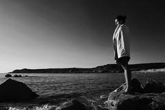 To the infinity and beyond, Sardegna (aledagosta) Tags: d60 nikond60 nikon scogli sasso piedi puntadipiedi gambe ragazza beach blackandwhite sardinia sea mare ritratti sardegna