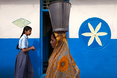 Street. Badami, India (Marji Lang Photography) Tags: 2013 asia badami inde india indian indiangirls indianpeople karnataka marjilang southasia southindia traveldestinations blue bucket candid colorphotography colorscene colorful colorfulbackground colorfulbuilding colors composition crossing dailylife documentary door females girl girls life lives metalbucket outdoors people photography saree sari school schoolgirl street streetart streetcomposition streetphotography streetshot travel traveldestination travelphotography twopersons urbanscene village wall woman womenonly