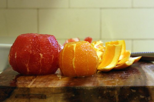 Oranges poised for sectioning