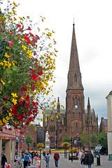 High Street view of Robert Burns Statue and Greyfriars Kirk, Dumfries-26 (Scott A. McNealy @noboundaryphotography) Tags: uk flowers people heritage scotland europe poetry riverside unitedkingdom redrose poet pedestrians robertburns highstreet hogmanay dumfries burnsnight tamoshanter thebard dumfriesandgalloway flowerbasket 1882 robertburnsnight auldlangsyne romanticmovement dumfrieshire rivernith carraramarble culturalicon republicanism ared toamouse robertburnsstatue aefondkiss amansamanforathat nationalpoetofscotland scotlandsnationalbard ploughmanpoet thebardofayrshire robertburnswalk scottamcnealyphotographer robdenofsolwayfirth scottishpoetandalyricist pioneeroftheromanticmovement scottishculturalicon greatestscot newyearsevesong toalouse thebattleofsherramuir riversidedumfriesmap greyfriarskirkdumfries dumfrieshighstreet highstreetflowerbasket