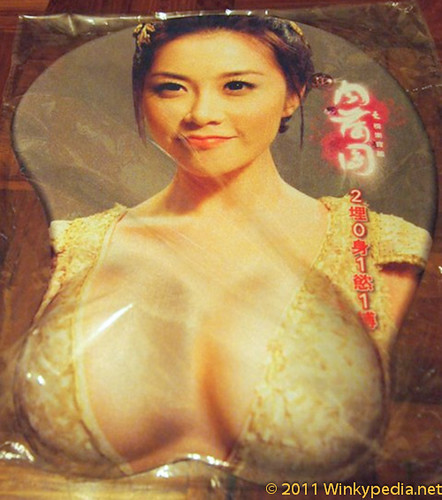 This is a promotional mouse pad for the first 3D erotic movie in Hong Kong.