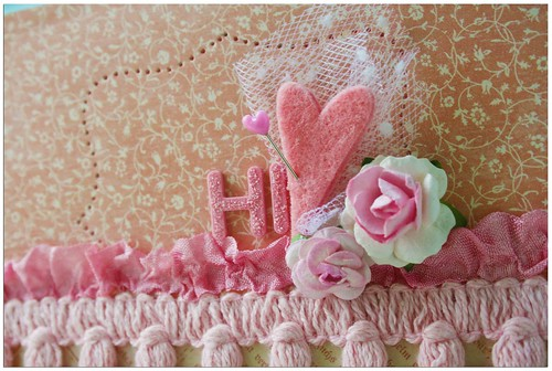 A pink Hi card closeup