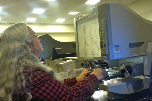 Mom reading microfilm