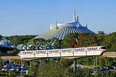 Passing Space Mountain (Ray Horwath) Tags: nikon contemporary disney disneyworld monorail nikkor wdw waltdisneyworld magickingdom spacemountain topaz contemporaryresort d300 cs4 disneytransportation nikkorlens horwath monorailred disneyphotos disneymountains nikkor18mm200mmlens rayhorwath disneymonorails topazadjust4