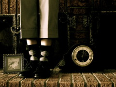 February 19, 2011:  Old Timer (sonyacita) Tags: brick clock glasses fireplace frame argylesocks utata:description=hide utata:project=ip120