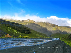 Estampa Precordillerana (Runa59) Tags: road sunset sky snow mountains green water colors rain fog clouds rural canon reflections trails bolivia tones lapaz runa lacumbre pramo precordillera bofedales mygearandme