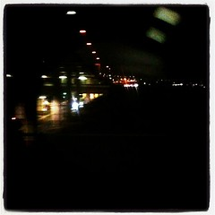 TXの車窓から。荒川超えて首都高くぐって、地下に潜ります。