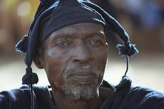 Dogon (ronniedankelman) Tags: africa travel portrait man face hat canon afrika mali tribe portret dogon stam afrique reizen gezicht hoed tirelli republicofmali républiquedumali malikafasojamana unpeupleunbutunefoi