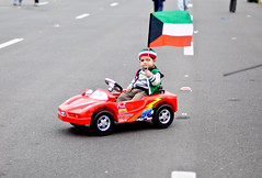 Kuwaiti and Proud (Jenan Altamimi) Tags: street red car proud happy photography 50mm child 26 flag 25 kuwait february kuwaiti nationalday liberationday jenanaltamimi