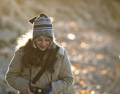 satisfaction (Andy Kennelly) Tags: california camera light portrait cold beach girl smile hat sunrise los rocks photographer braces angeles photos bokeh daughter young pebbles jacket satisfaction verdes palos enamored