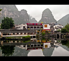 The Most Picturesque McDonald's in the World, Yangshuo (China) (departing(YYZ)) Tags: china bridge food mist mountains reflection green water beautiful fog contrast landscape happy corporate restaurant mirror golden asia yangshuo gorgeous fastfood fast peaceful arches ps cliffs mcdonalds panasonic chain meal takeout western limestone pointandshoot serene karst picturesque cheap epic tranquil consumerism yyz departing 2010 myst franchise karsts mostbeautifulmcdonaldsintheworld departingyyz