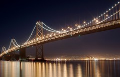 Bay Bridge at Night (D.H. Parks) Tags: sanfrancisco longexposure nightphotography reflections stack baybridge sanfranciscobay hdr average cliche chirp nub portofoakland yerbabuenaisland sigma3014 sunstars sigma30mmf14 enfuse exposurefusion