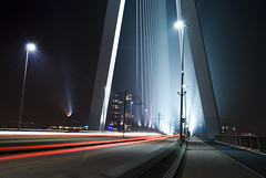 Erasmusbrug Rotterdam by night (Marco Boekestijn) Tags: city bridge blue light sunset white haven holland water netherlands skyline architecture modern night river de photography evening design swan haze rotterdam nikon fotografie erasmus shots harbour nederland landmark delft marco brug van avond maas kopvanzuid kop erasmusbrug zuid nieuwe zwa