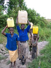 Smiley kinds with their jerry cans