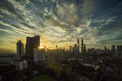 Glittering Sunrise: Kuala Lumpur (Mohamad Zaidi Photography) Tags: kualalumpur kualalumpurcitycenter kampungbaru malaysia malaysianphotographer mohamadzaidiphotography mohamadzaididotcom sonya7r laowa15mm laowa laowa15mmf4 ultrawidemacro sunrise sunstar city nopeople travel cloudsformation forsale