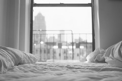 city mornings (scott w. h. young) Tags: city nyc newyorkcity light love window skyline 35mm canon bed sheets 200 scala mornings agfa canonetql17giii